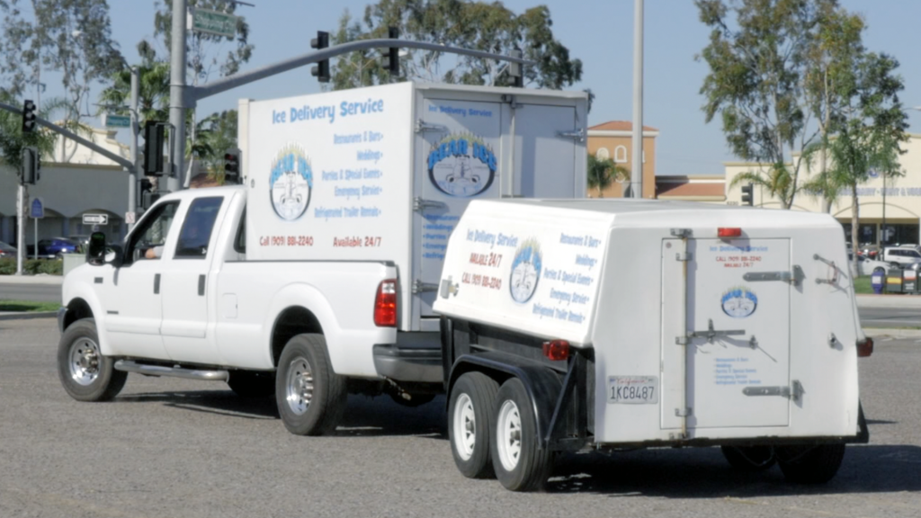 Ice delivery truck supplying ice to client
