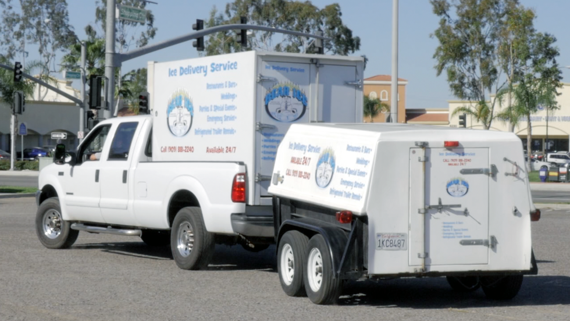 Bear Ice delivery service truck with a refrigerated container hauling a refrigerated trailer